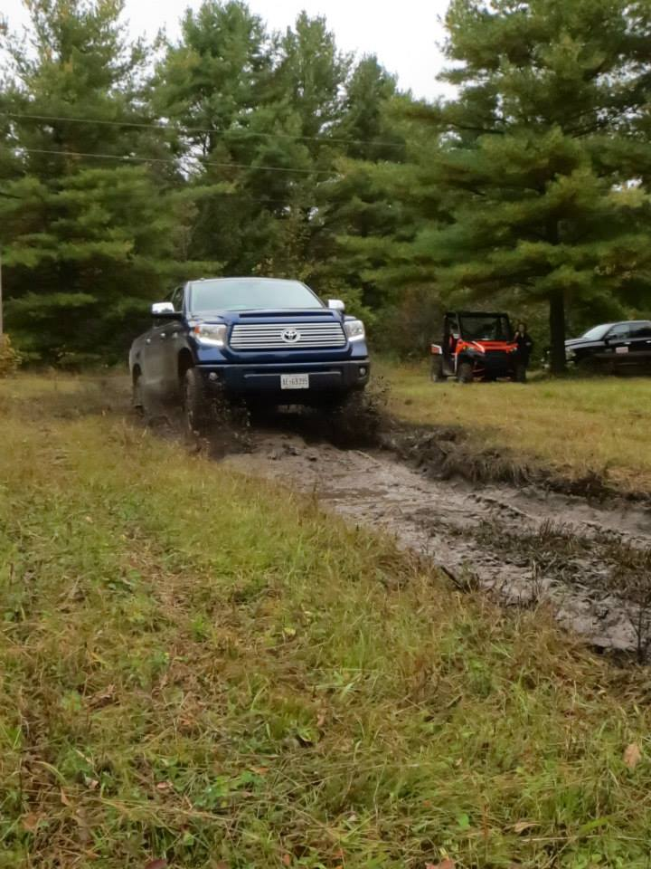 The 2014 Toyota Tundra running (or jumping!) on the off-road course